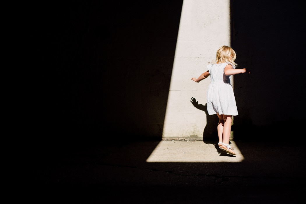 Milwaukee Lifestyle Photographer | Young girl jumping with her shadow.